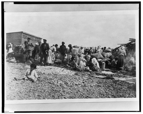 Armenian refugees with salvaged property on the Black Sea coast. Novorossiysk, Russia, 1920.